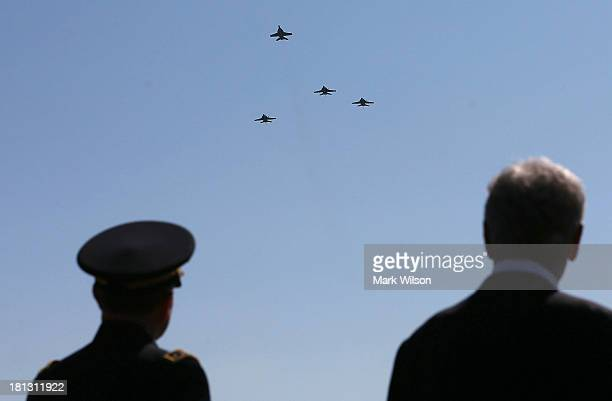 S Secretary of Defense Chuck Hagel and Chairman of the Joint Chiefs of Staff Gen Martin E Dempsey watch military jets perform fly over in the missing...