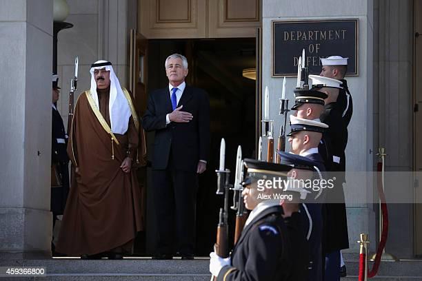 S Secretary of Defense Chuck Hagel and Saudi National Guard Minister Prince Mitib bin Abdallah bin Abd alAziz Al Saud listen to national anthems at...