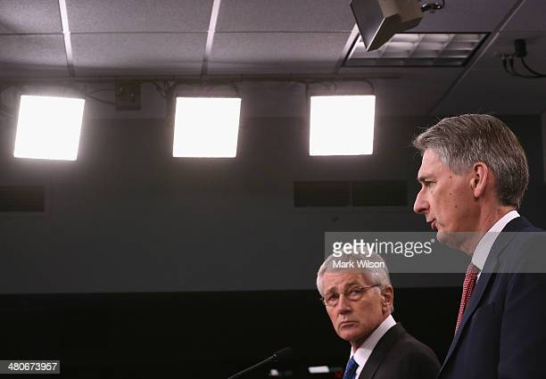 S Secretary of Defense Chuck Hagel and United Kingdom Secretary of State for Defense Philip Hammond answer questions from the media during a briefing...