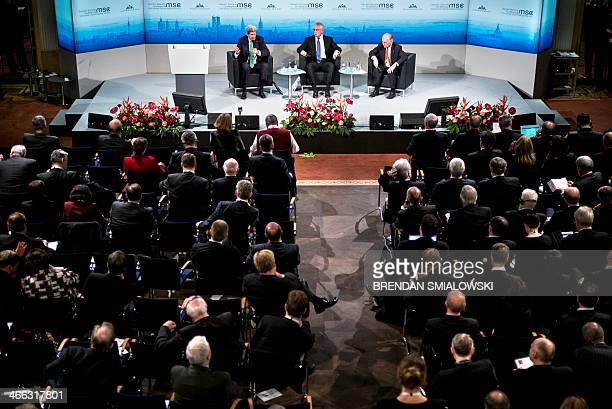 US Secretary of Defense Chuck Hagel and Wolfgang Ischinger chairman of the Munich Security Conference listen as US Secretary of State John Kerry...