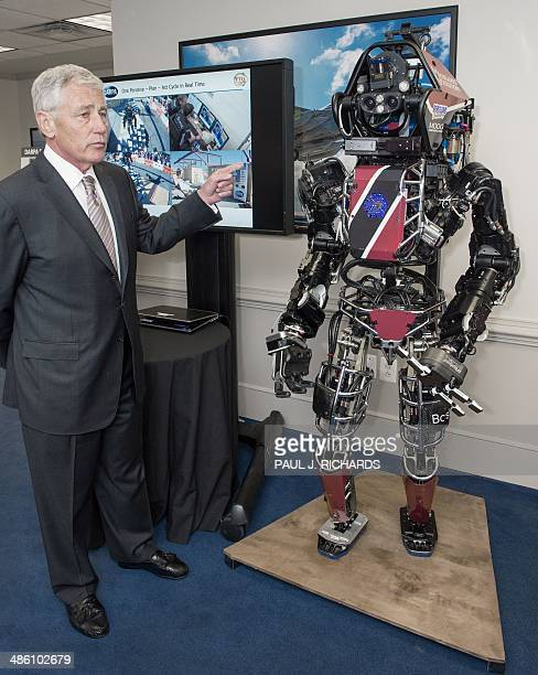 US Secretary of Defense Chuck Hagel is briefed on the ATLAS ROBOT which is one of the most advanced humanoid robots ever built April 22 at the...