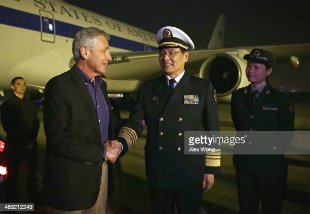 S Secretary of Defense Chuck Hagel is welcomed by Sun Jianguo Deputy Chief of General Staff of the Chinese Peoples Liberation Army upon his arrival...