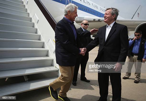 S Secretary of Defense Chuck Hagel is welcomed by US Ambassador to China Max Baucus upon his arrival at Qingdao International Airport April 7 2014 in...