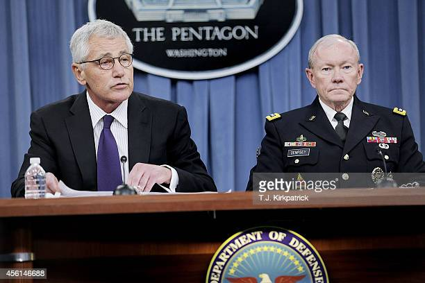 Secretary of Defense Chuck Hagel left and Joint Chiefs of Staff Chairman General Martin Dempsey speak to the press about the ongoing bombing campaign...