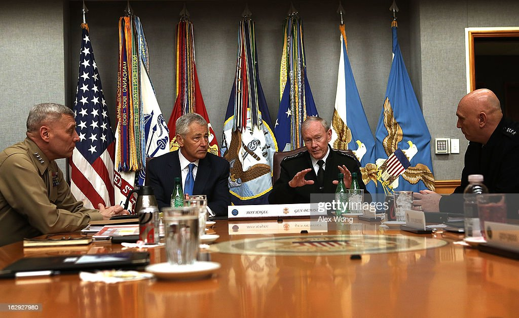 U.S. Secretary of Defense Chuck Hagel (2nd L) meets with (L-R) Marine Corps Assistant Commandant General John Paxton, Chairman of the Joint Chiefs of Staff General Martin Dempsey, and Army Chief of Staff General Raymond Odierno at the Joint Chiefs Conference Room, also known as the 'tank,' March 1, 2013 at the Pentagon in Arlington, Virginia. Secretary Hagel participated in a meet-and-greet with the members of the Joint Chiefs of Staff.