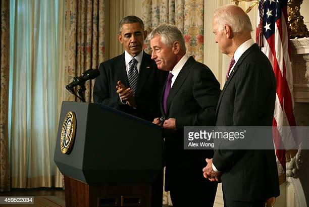 S Secretary of Defense Chuck Hagel pauses as he speaks as President Barack Obama and Vice President Joseph Biden listen during a press conference...