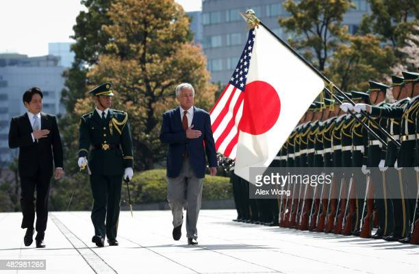 S Secretary of Defense Chuck Hagel reviews honor guards accompanied by Japanese Defense Minister Itsunori Onodera at the Japanese Ministry of Defense...