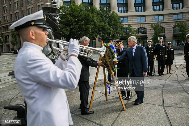 S Secretary of Defense Chuck Hagel right and Chairman of the Joint Chiefs of Staff Gen Martin Dempsey left lay a wreath in honor of the Navy Yard...