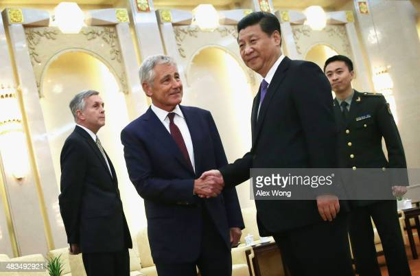 Secretary of Defense Chuck Hagel shakes hands with Chinese President Xi Jinping during a meeting at the Great Hall of the People April 9, 2014 in...