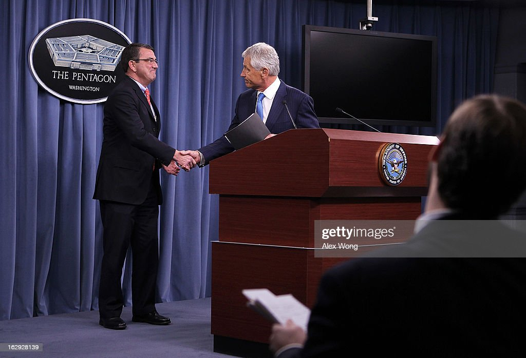 U.S. Secretary of Defense Chuck Hagel (R) shakes hands with Deputy Secretary of Defense Ashton Carter (L) during a news briefing March 1, 2013 at the Pentagon in Arlington, Virginia. Secretary Hagel spoke on the impact of the sequestration to the Department of Defense.