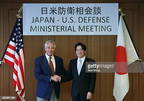 S Secretary of Defense Chuck Hagel shakes hands with Japanese Defense Minister Itsunori Onodera prior to a bilateral meeting at the Japanese Ministry...