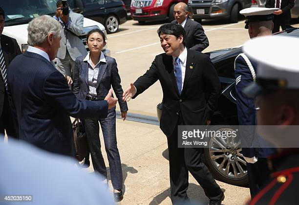 S Secretary of Defense Chuck Hagel shakes hands with Japanese Minister of Defense Itsunori Onodera during an arrival at the Pentagon July 11 2014 in...