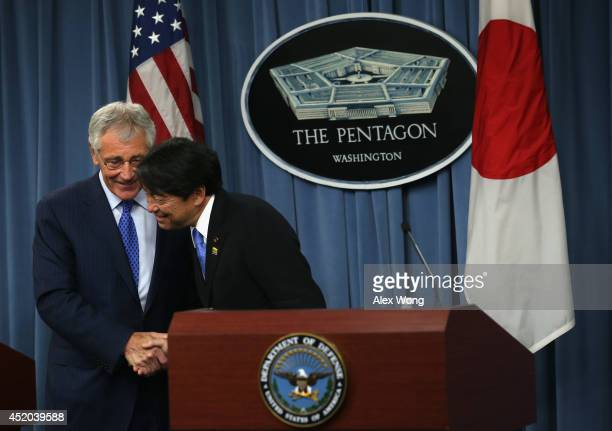 S Secretary of Defense Chuck Hagel shakes hands with Japanese Minister of Defense Itsunori Onodera during a joint news conference at the Pentagon...
