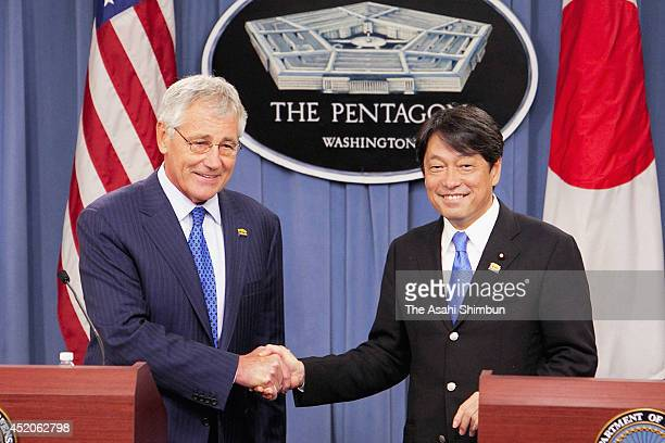 US Secretary of Defense Chuck Hagel shakes hands with Japanese Minister of Defense Itsunori Onodera during a joint news conference at the Pentagon...