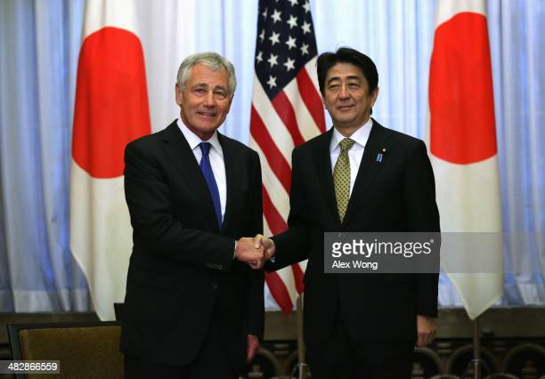 S Secretary of Defense Chuck Hagel shakes hands with Japanese Prime Minister Shinzo Abe during a meeting on April 5 2014 at the prime minister's...