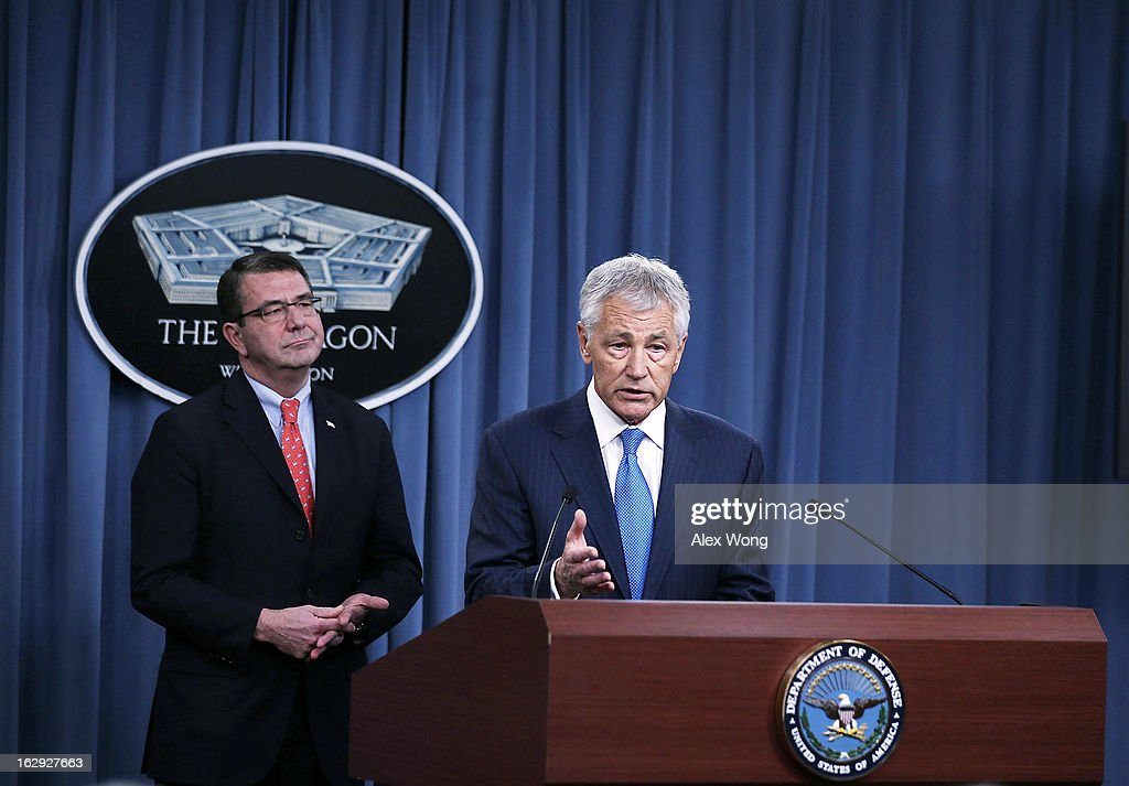 U.S. Secretary of Defense Chuck Hagel (R) speaks as Deputy Secretary of Defense Ashton Carter looks on during a news briefing March 1, 2013 at the Pentagon in Arlington, Virginia. Secretary Hagel spoke on the impact of the sequestration to the Department of Defense.