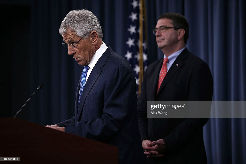 U.S. Secretary of Defense Chuck Hagel (L) speaks as Deputy Secretary of Defense Ashton Carter (R) looks on during a news briefing March 1, 2013 at the Pentagon in Arlington, Virginia. Secretary Hagel spoke on the impact of the sequestration to the Department of Defense.