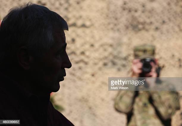 S Secretary of Defense Chuck Hagel speaks to media pool members after visiting with American troops December 7 2014 in FOB Gamberi Afghanistan...