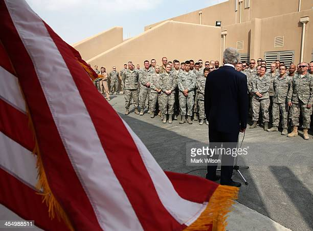 S Secretary of Defense Chuck Hagel speaks to troops gathered on December 10 2013 at Al Udeid Airbase Qatar Secretary Hagel ended his six day trip in...