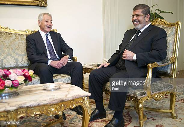 Secretary of Defense Chuck Hagel speaks with Egyptian President Mohamed Morsi at the Presidential Palace on April 24, 2013 in Cairo, Egypt. The U.S....