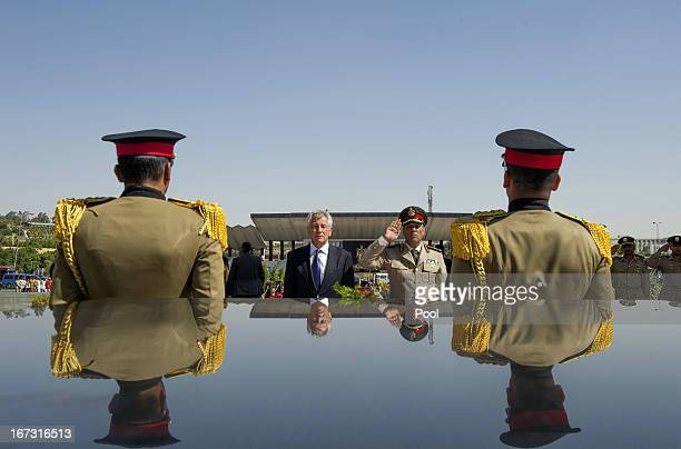 S Secretary of Defense Chuck Hagel stands with an Egyptian army official before laying a wreath at the tomb of late president Anwar alSadat on April...