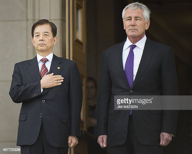 US Secretary of Defense Chuck Hagel stands with South Korean Minister of National Defense Han Minkoo as he arrives for a bilateral meeting at the...
