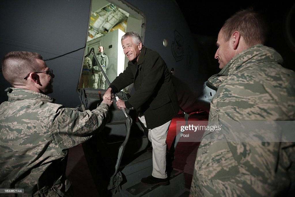 S. Secretary of Defense Chuck Hagel (C) steps aboard a C-17 military aircraft en route to Kabul, Afghanistan, after greeting U.S. troops March 8, 2013 at Manas Air Force Base in Kyrgyzstan. Hagel is making his first official trip since being sworn-in as U.S. Defense Secretary.