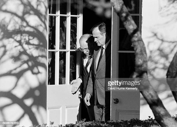 S Secretary of Defense Dick Cheney reports to President George HW Bush at the White House after his Mideast mission Februrary 12 1991 in Washington...