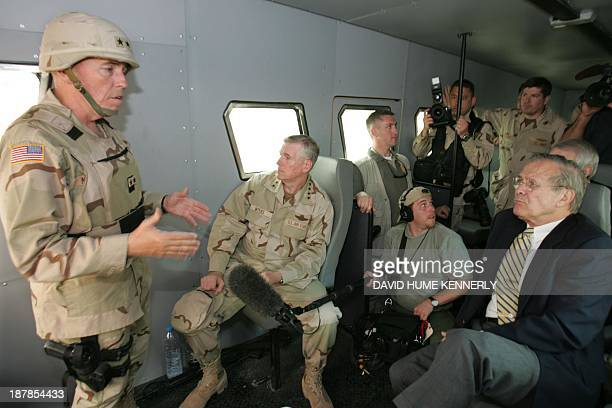 US Secretary of Defense Donald Rumsfeld and Chairman of the Joint Chiefs of Staff Richard Myers are briefed by Major General Geoffrey Miller the...