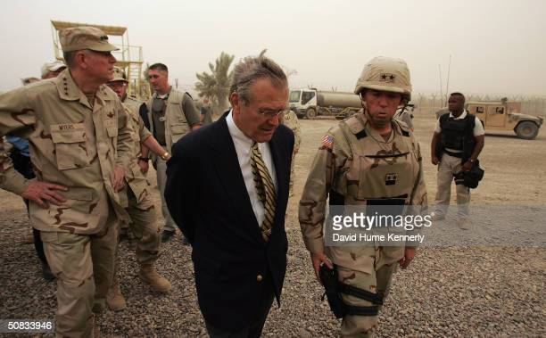 US Secretary of Defense Donald Rumsfeld and Chairman of the Joint Chiefs of Staff Richard Myers are briefed by Major General Geoffry Miller the...
