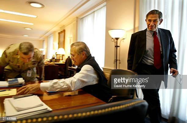US Secretary of Defense Donald Rumsfeld and Deputy Secretary of Defense Paul Wolfowitz meet with CENTCOM Commander General John Abizaid in Rumsfeld's...