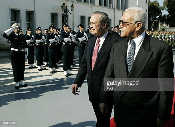 S Secretary of Defense Donald Rumsfeld and his Algerian counterpart Abdelmalek Guenaizia take part in a military ceremony at the Defense Ministry...