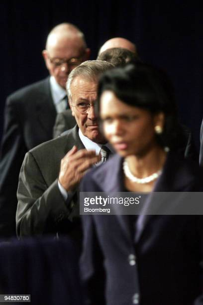 Secretary of Defense Donald Rumsfeld, center, and US Secretary of State Condoleezza Rice, front, arrive for a speech by US President George W. Bush...