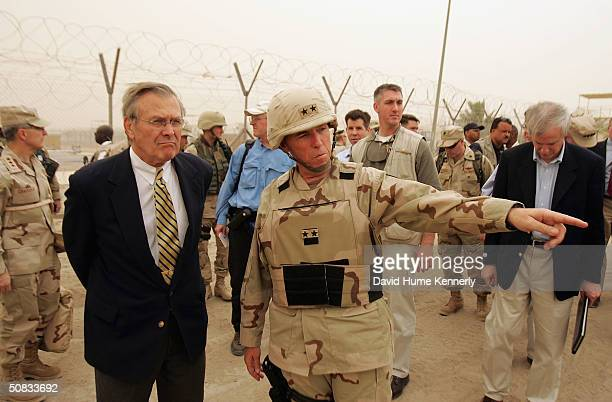 S Secretary of Defense Donald Rumsfeld is briefed about detainee operations by Major General Geoffry Miller the Deputy Director of Detainee...