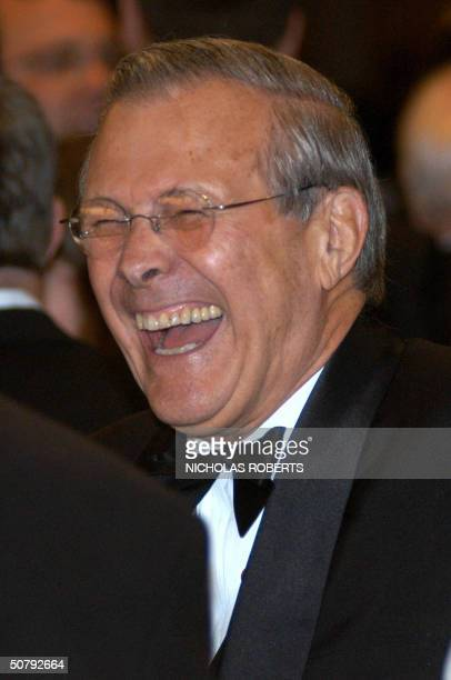 Secretary of Defense Donald Rumsfeld laughs while mingling with others at the White House Correspondents' Association dinner in Washington DC 01 May...