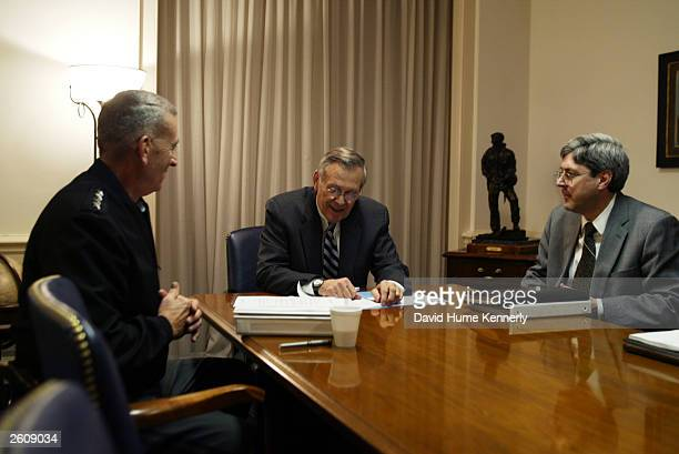 Secretary of Defense Donald Rumsfeld meets with CENTCOM commander General Tommy Franks and Under Secretary of Defense for Policy Douglas J. Feith at...