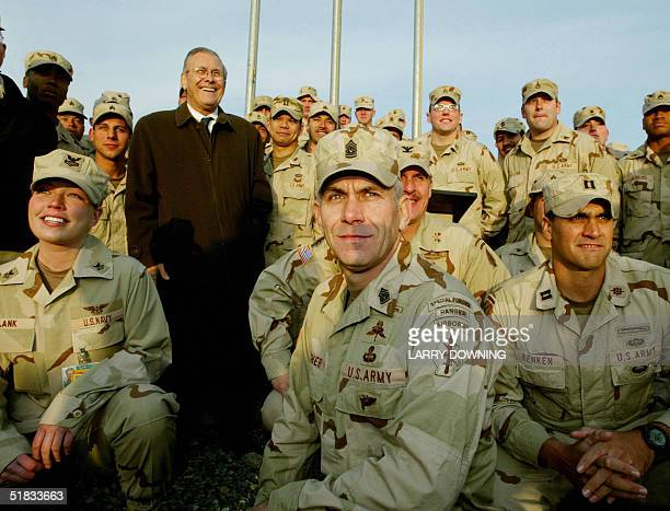 Secretary of Defense Donald Rumsfeld poses with US military Special Operations personnel at Bagram Air Base in Afghanistan to start his visit to the...