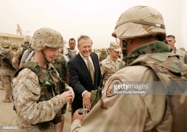 S Secretary of Defense Donald Rumsfeld shakes hands with American soldiers at Abu Ghraib prison May 13 2004 in Baghdad Iraq Rumsfeld greeted American...