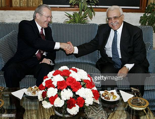 S Secretary of Defense Donald Rumsfeld shakes hands with his Algerian counterpart Abdelmalek Guenaizia as they meet at the Defense Ministry February...
