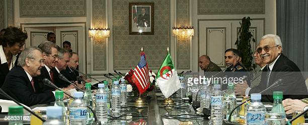 S Secretary of Defense Donald Rumsfeld sits across the table from his Algerian counterpart Abdelmalek Guenaizia as they meet at the Defense Ministry...