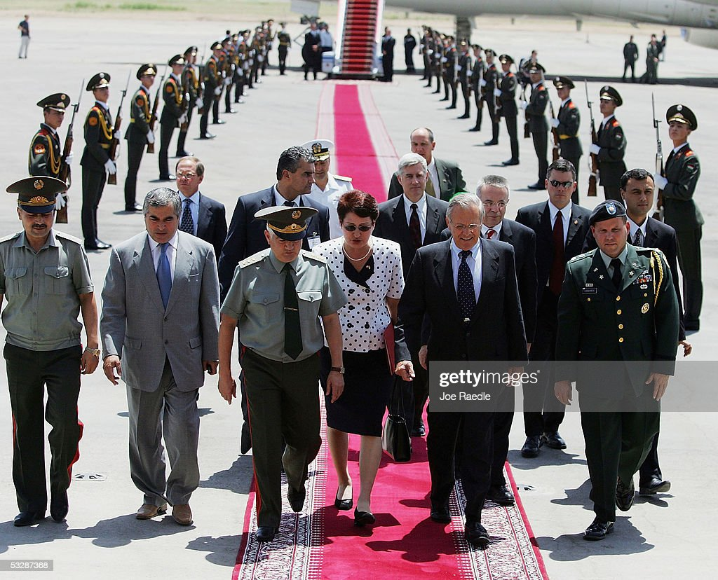 U.S. Secretary of Defense Donald Rumsfeld (Front, 2nd from R) walks with Tajikistan Minister of Defense Colonel General Sherali Khairulloyev (Front, 3rd from L) as he arrives July 26, 2005 in Dushanbe, Tajikistan. He met with the President to speak about the relationship between the United States and Tajikistan.