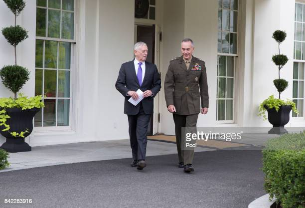 US Secretary of Defense James Mattis and Chairman of the Joint Chiefs of Staff Joseph Dunford walk to the microphones to make a statement at the...
