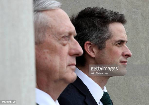 S Secretary of Defense James Mattis and Gavin Williamson Secretary of State for Defense United Kingdom listen to the US national anthem during an...