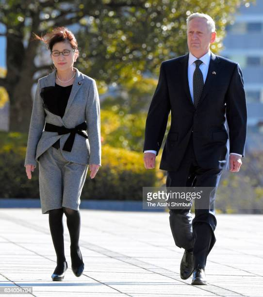 US Secretary of Defense James Mattis and Japanese Defense Minister Tomomi Inada review the honour guard at Defense Ministry on February 4 2017 in...