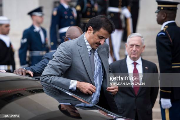 US Secretary of Defense James Mattis and Qatar's Emir Sheikh Tamim Bin Hamad AlThani during an honor cordon at the Pentagon April 9 2018 in...