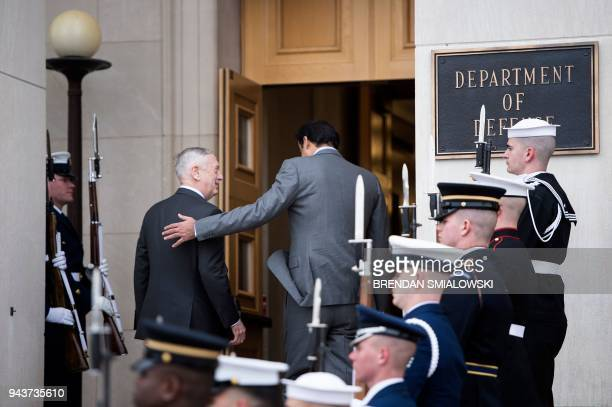 US Secretary of Defense James Mattis and Qatar's Emir Sheikh Tamim Bin Hamad AlThani walk to a meeting at the Pentagon April 9 2018 in Washington DC...