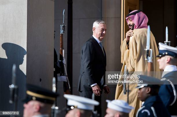 US Secretary of Defense James Mattis and Saudi Arabia's Crown Prince Mohammad Bin Salman walk towards the Pentagon during an honor cordon March 22...