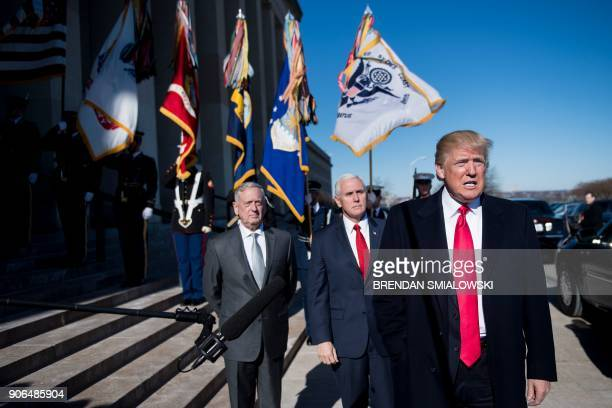 US Secretary of Defense James Mattis and US Vice President Mike Pence listen while US President Donald Trump speaks to the press before a meeting in...