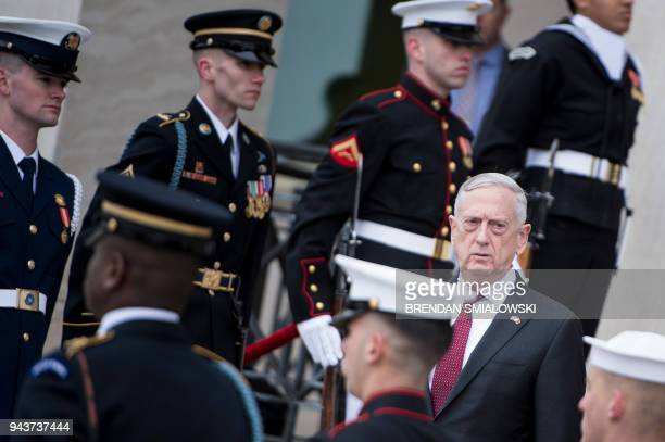 US Secretary of Defense James Mattis awaits the arrival of Qatar's Emir Sheikh Tamim Bin Hamad AlThani during an honor cordon at the Pentagon April 9...