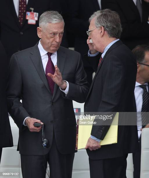 S Secretary of Defense James Mattis chats with National Security Advisor John Bolton prior to the opening ceremony at the 2018 NATO Summit at NATO...